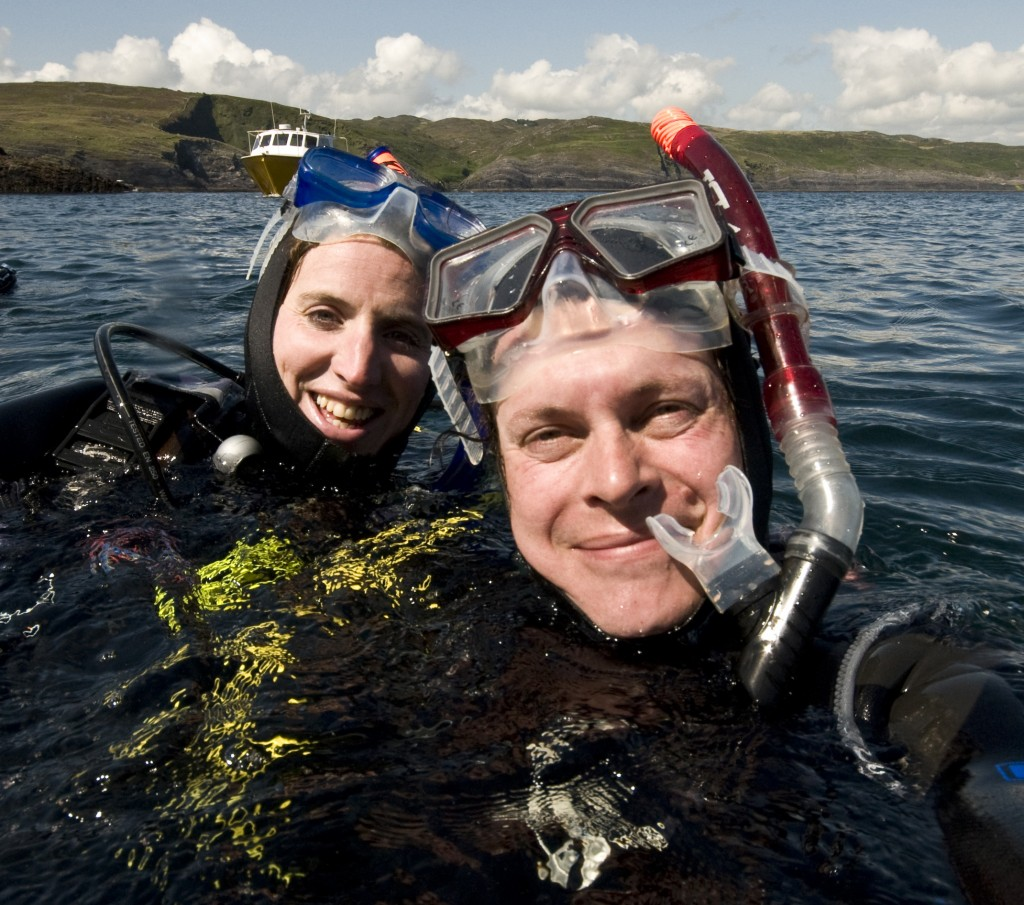 Two divers staring at the camera